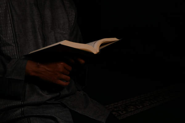 man reading in dim light