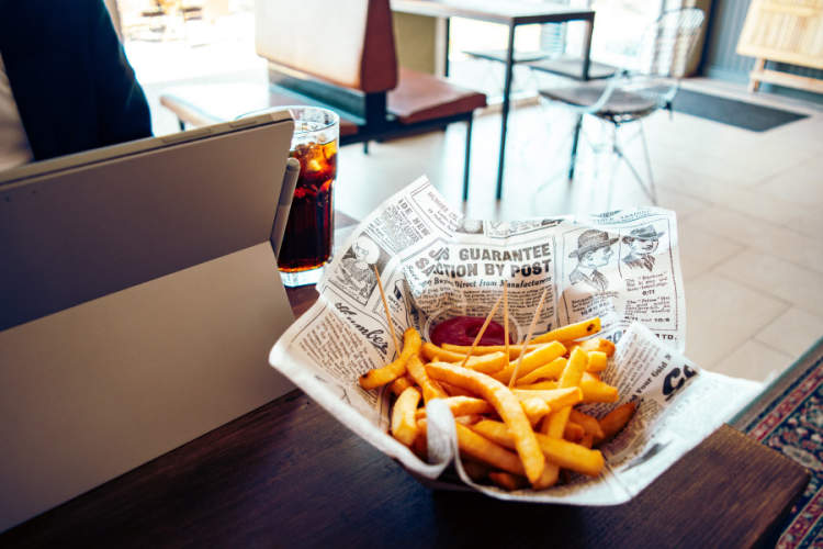 french fries and soda on a table