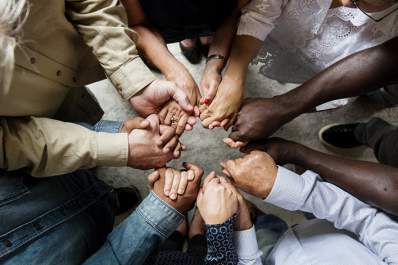 A circle of hands linked in support.
