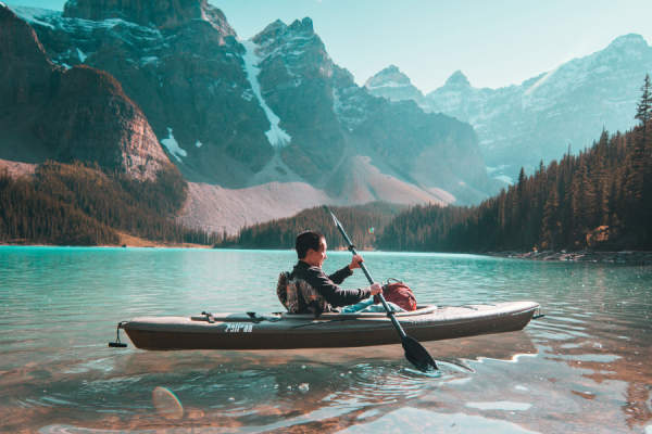 person kayaking in nature