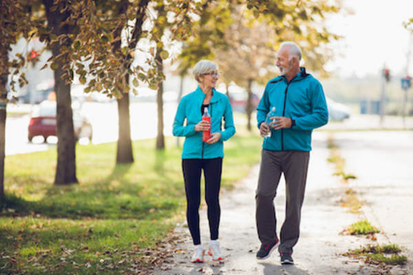 Couple walking for exercise.