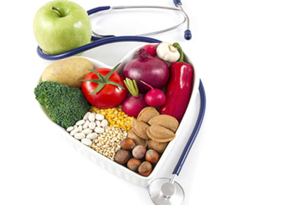 Heart healthy food and a stethoscope.