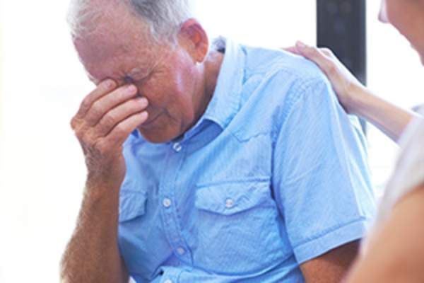 Elderly man grieving for his wife image.