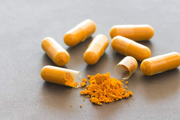 Herbal tumeric supplement capsules.