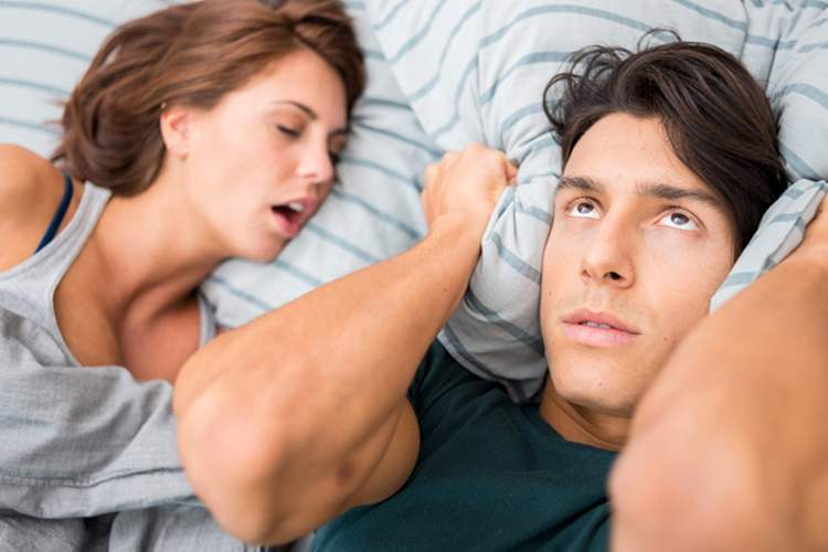 Woman snoring and partner cannot sleep.