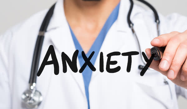 Anxiety concept doctor writing out anxiety