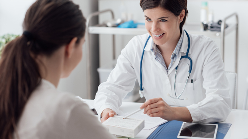 Doctor explaining helpful medication to a patient.