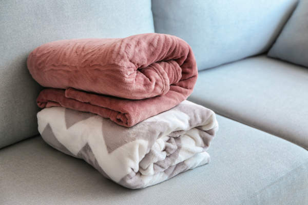 folded blankets on couch