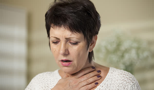 woman having trouble breathing image