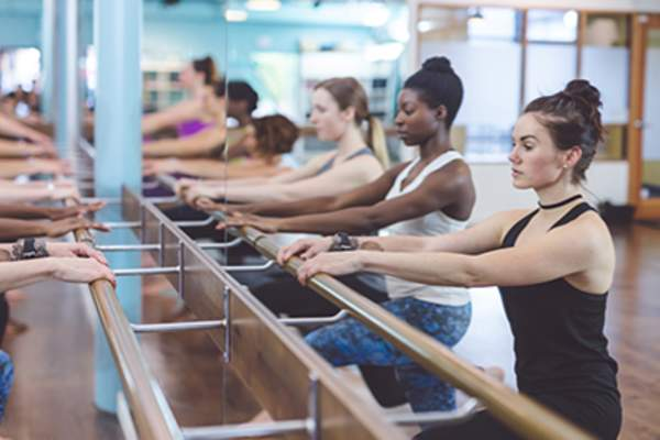 Women doing barre workout