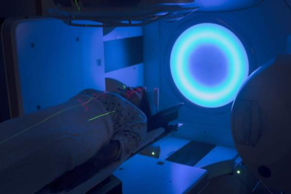 Woman undergoing radiation therapy.