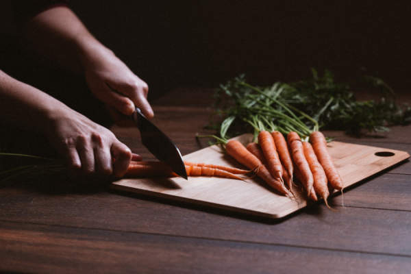 woman cutting carrots