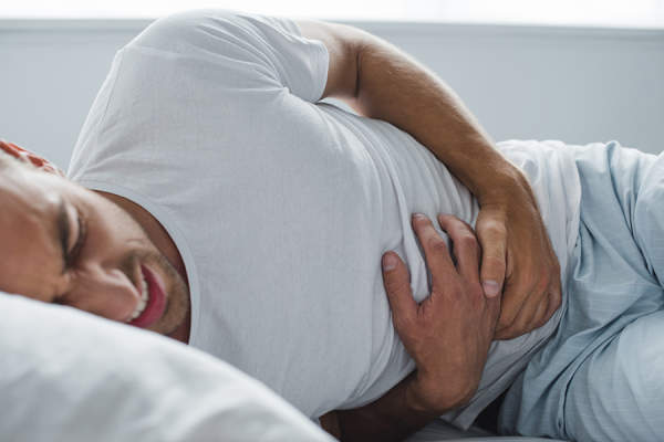Man unable to sleep due to stomach pain