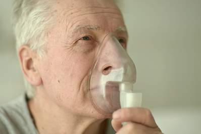 Senior man with an oxygen mask.