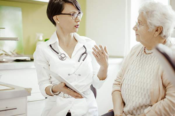 Doctor talking to senior woman.
