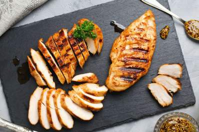 Grilled chicken on a cutting board.