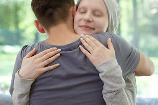 Cancer patient hugging supporter.