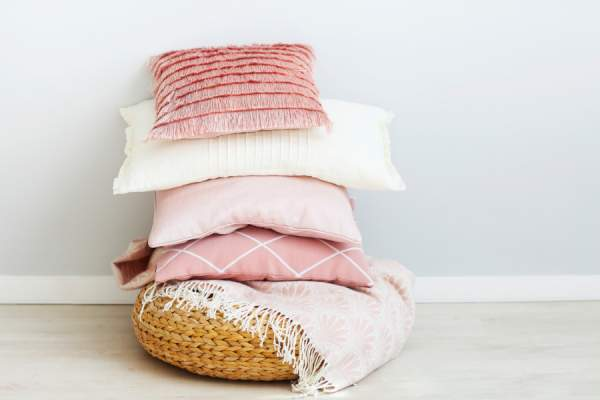 pillows and blanket in a basket