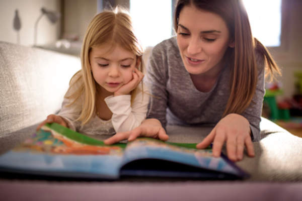 Mother and daughter read a book.