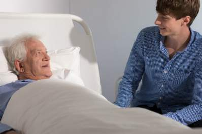man at grandfathers side in hospice