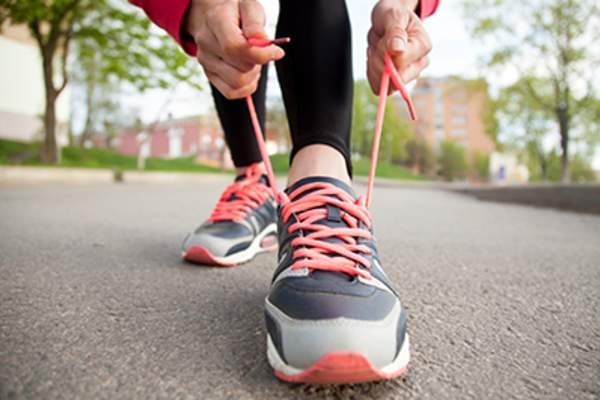Jogger tying shoelaces.