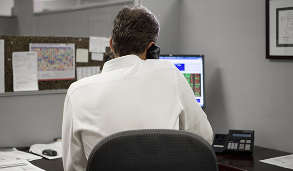 man on the phone at work image