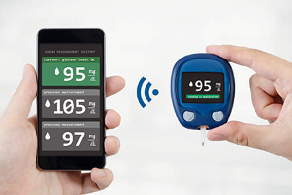 Glucose meter syncing with a smartphone.