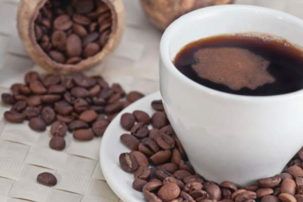 cup of coffee and coffee beans image