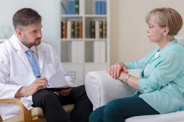 Older woman talking to therapist