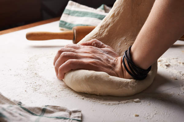 hands kneading bread