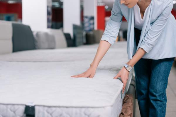 Woman shopping for mattress