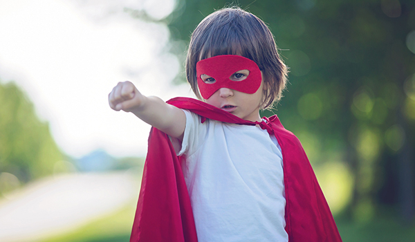 Child in superhero costume, fight or flight concept.