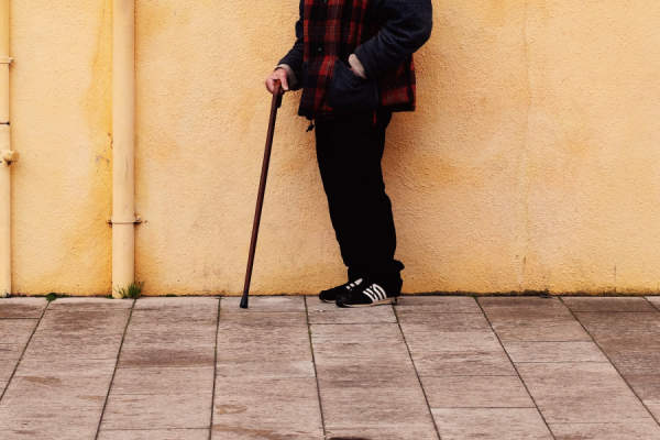 man on the street with a cane