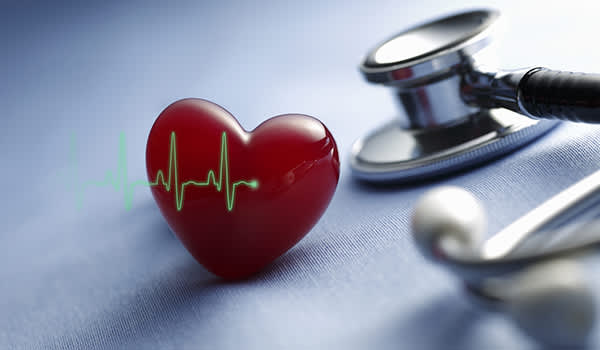 Stethoscope and heart with EKG.