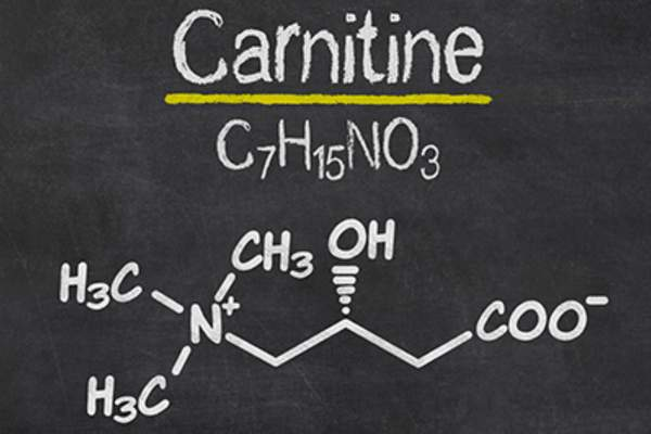 Blackboard with the chemical formula of carnitine.