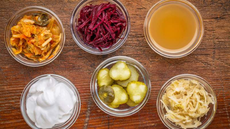 Fermented high probiotic foods arranged in small jars.