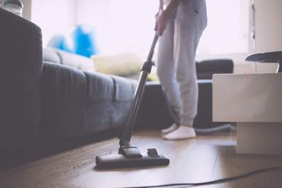 Woman cleaning the floor image.