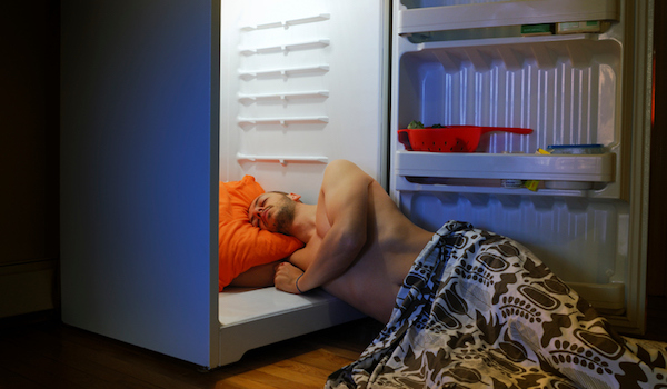to hot to sleep, head in refrigerator.