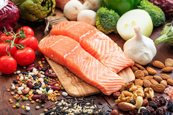Salmon with fruits, vegetables, and legumes.