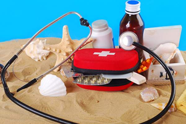Beach emergency kit with medical supplies.