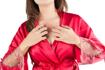 Woman in red robe, scratching her chest.