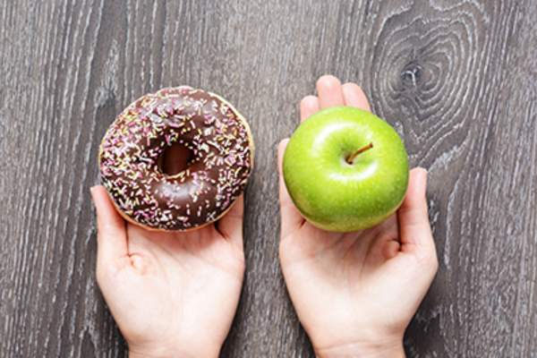 Choosing between a doughnut and an apple.
