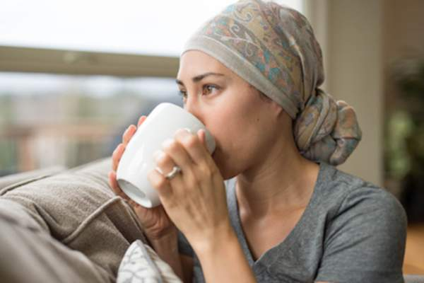 Chemo patient drinking warm water.