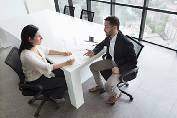 Man and woman having business meeting.