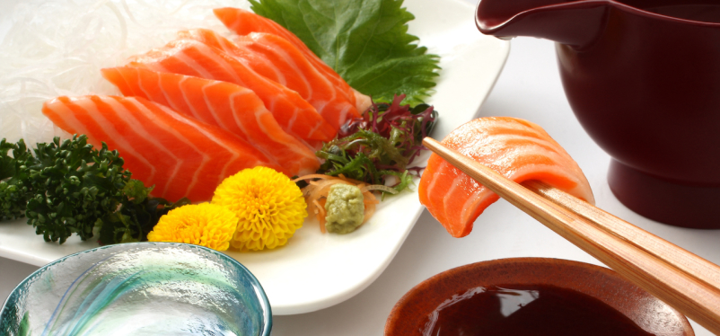 Eating salmon Sashimi