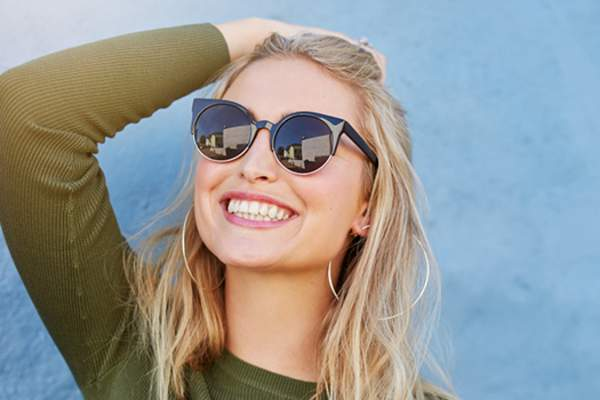 Woman wearing sunglasses image.