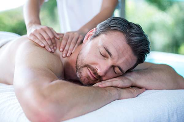 Man receiving a back massage.