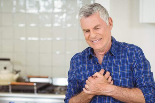 man suffering chest pain