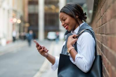Woman smiling while talking on her phone.