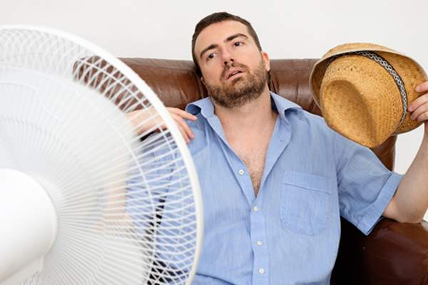 man too hot on vacation image